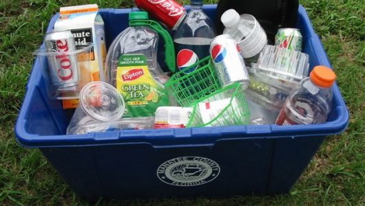 Green And Recycle Plastic in recycle bin