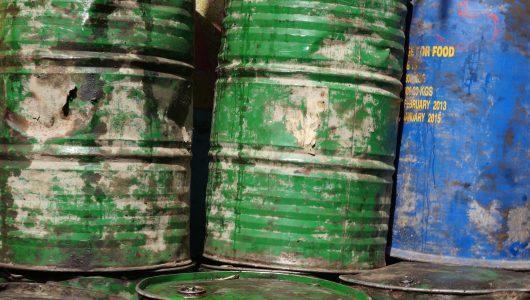 Three hazardous waste disposal barrels