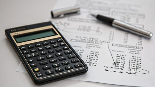calculator with pen and paper to carry out a waste audit
