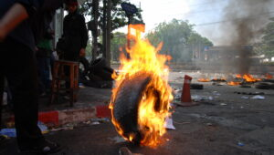 Burning tire for incinerating waste