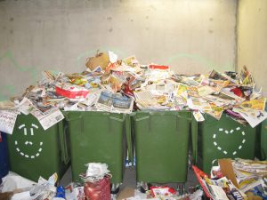 Overflowing green business recycling bins