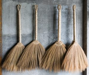 Four traditional wooden brooms