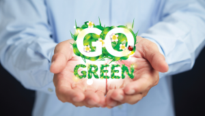 Go green being held up in persons hands