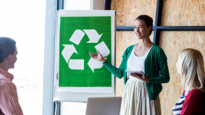 Business meeting outlining business recycling goals