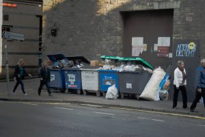 Commercial waste collection bins overflowing