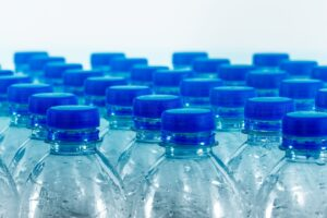 Plastic water bottles with blue lids