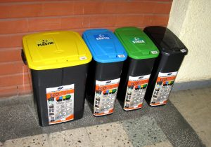 Four coloured business recycling bins
