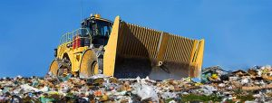 Yellow truck on food waste landfill