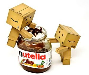 Two cardboard box men eating from nutella jar