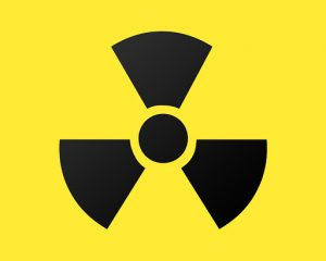 Radioactive hazardous waste symbol on yellow background