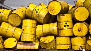 Yellow hazardous waste barrels piled up