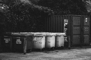 commercial bins outside black and white