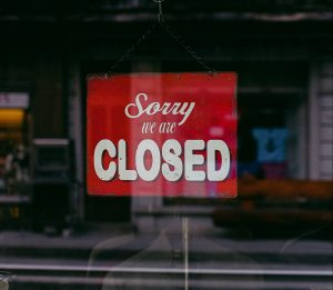 A closed sign on a business after lockdown