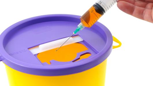 Sharps bin with needle